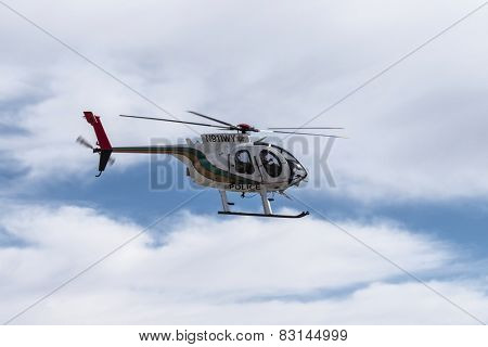 LAS VEGAS, NEVADA, USA - February, 6,2015:  Las Vegas Metropolitan Police helicopter speeding by on patrol.
