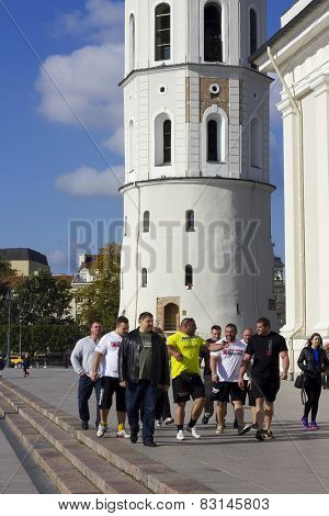 Athletes Walk On The Old Town