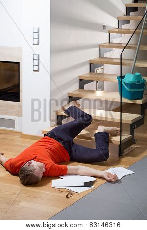 Injured Man Lying On The Floor