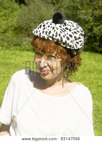 Woman In White Hat With Black Spots