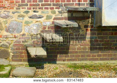Steps In Brick Wall. Bosham. England