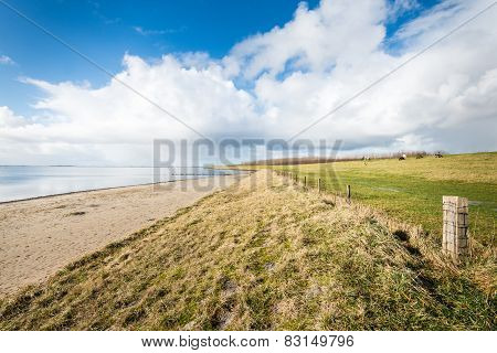 Beach And A Dike Along A Dutch Estuary