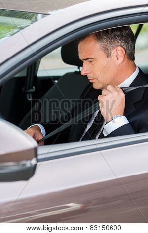 Fastening His Seat Belt.