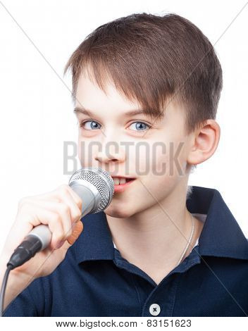 Cheerful boy holding microphone singing or speaking on white background