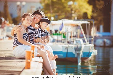 Family resting near the yacht club in the summer.