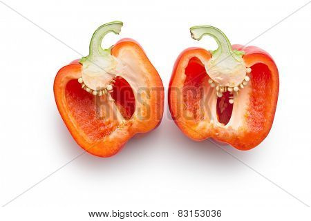 halved red bell pepper on white background