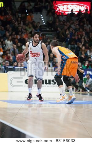 VALENCIA, SPAIN - FEBRUARY 15: Campazzo with ball, Nedovic during Spanish League match between Valencia Basket Club and Real Madrid at Fonteta Stadium on February 15, 2015 in Valencia, Spain