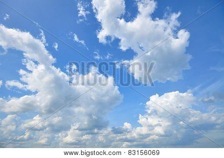 White Cumulus Clouds In The Sky