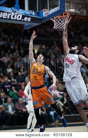 VALENCIA, SPAIN - FEBRUARY 15: Ribas 5 and Bourousis 30 during Spanish League match between Valencia Basket Club and Real Madrid at Fonteta Stadium on February 15, 2015 in Valencia, Spain