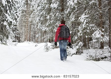 Photographer In Winter Landscape