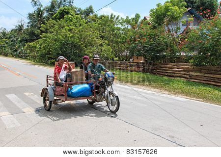Puerto Princesa, Philippines - January 12,2015: Three People On A Tricycle In The Philippines