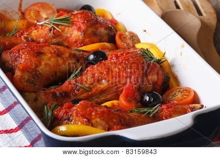 Chicken Legs Baked In Tomato With Olives Closeup. Horizontal