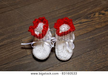 baby's bootee on wooden background