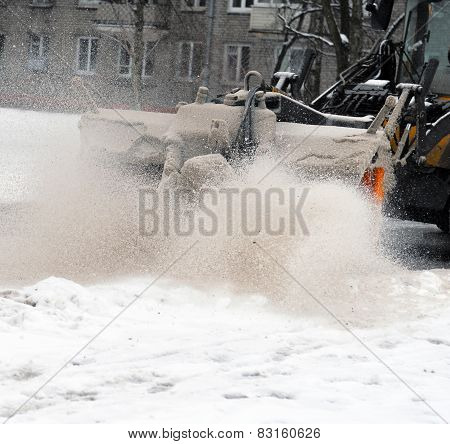Cleaning Of The Street. Snow And Sand.