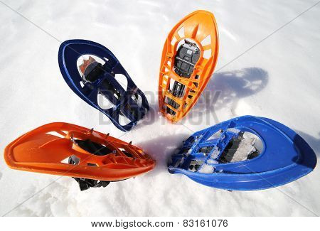 Four Modern Snowshoes In The Mountain