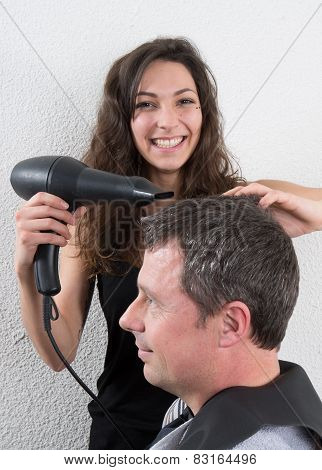Handsome Man At The Hairdresser Blow Drying His Hair