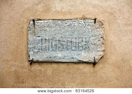 Marble Signboard Hold By Rusty Nails