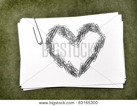 White paper cards with paperclip heart love business