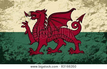Welsh flag. Grunge background. Vector illustration