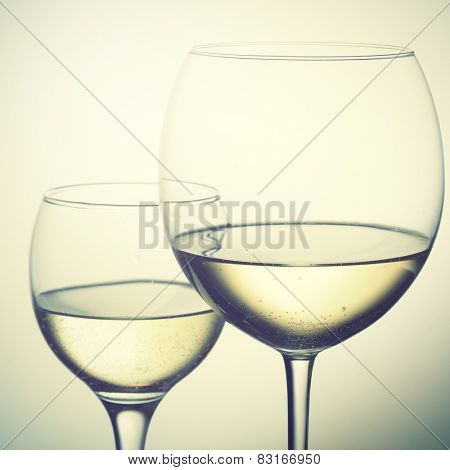 Two glasses of white wine. Instagram style filtred image