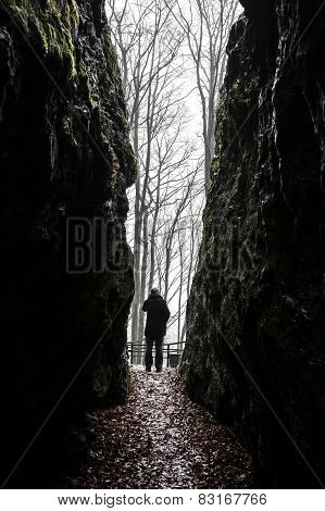Man Exiting Dark Cave