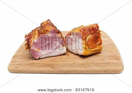 Smoked Pork Neck On A Wooden Cutting Board On White Background