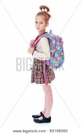 Beautiful elegant schoolgirl with satchel on his back.