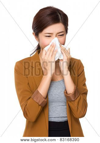 Businesswoman sneeze