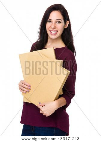 Woman holds  folders