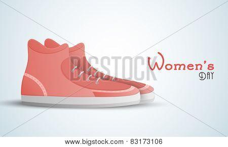 Girls shoes on blue background on International Women's Day celebrations.