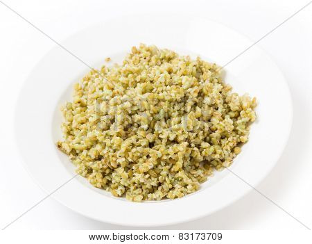 A bowl of freshly boiled cracked freekeh scorched green wheat grains, one of the