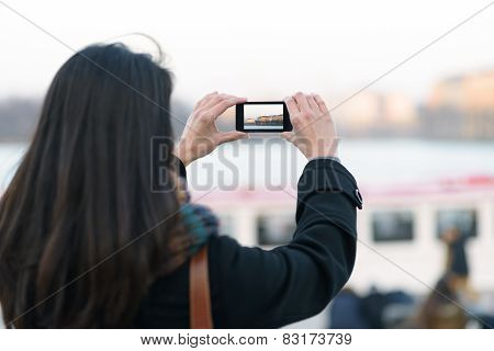 Woman Taking Outdoor View Using Mobile Phone