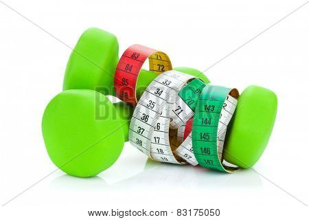 Two green dumbells and tape measure. Fitness and health. Isolated on white background