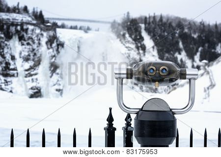 Tourist  binoculars  for viewing the frozen waterfall at the Monmerency Falls, Quebec City, Canada.