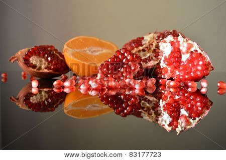 Garnet and half orange reflected in the glass