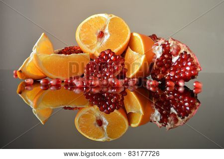 Still life of orange and pomegranate