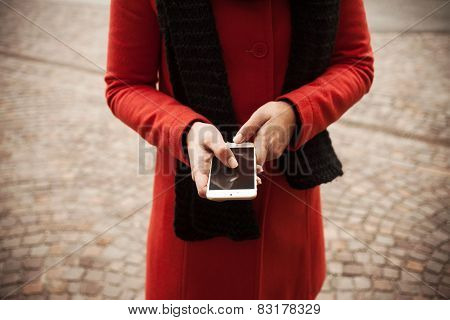 Woman In The Street Using Her Mobile