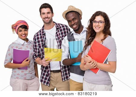 Smiling university students holding notebook on white background
