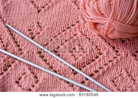Knitted Element Pink Skein Of Yarn And Knitting Needles