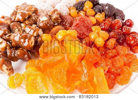 Candied pumpkin, cherries, peaches and walnuts in a plum fruit candy