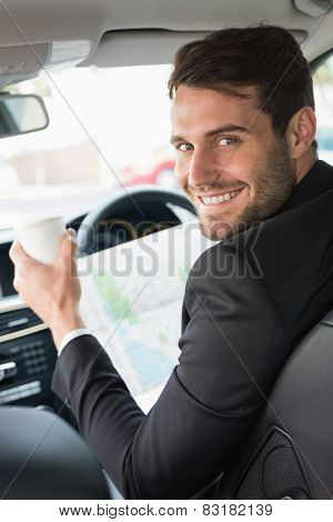 Young businessman reading a map in his car