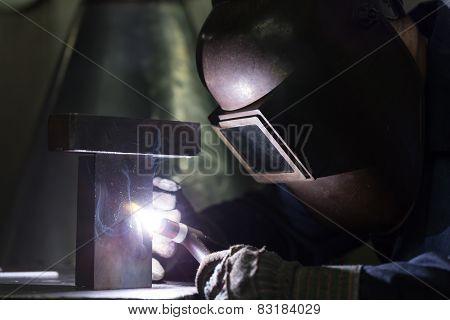 Professional Welder Welding Metal Parts