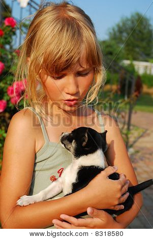Young Girl With Little Puppy