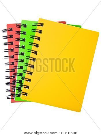 Three colorful notebooks