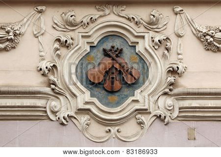 House at the Three Little Violins. House sign at the house in Mala Strana in Prague, Czech Republic.