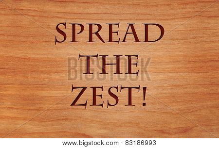 Spread the zest - an inspirational quote on wooden background
