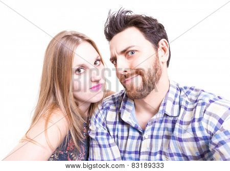 Couple taking a selfie photo on white background