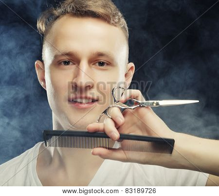 portrait of young t hairstylist looking at camera