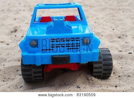 Blue Toy Car On The Sand
