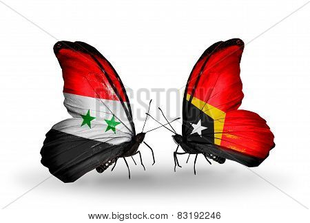 Two Butterflies With Flags On Wings As Symbol Of Relations Syria And East Timor
